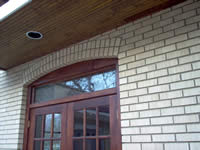 This detail shows another flat lock seam copper roof with integral gutter. Installed over a bay window.