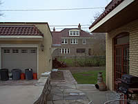 After: Front view: garage and laundry room-breezeway